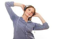 Young woman listening music in headphones Royalty Free Stock Photo