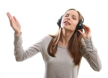 Young woman listening music with headphones Royalty Free Stock Photo