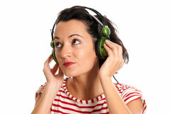 Young woman listening music headphones isolated. Young woman listening music with headphones isolated on white background Royalty Free Stock Image