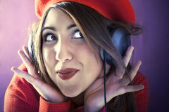 Young woman listening music with headphones. Vintage phones Stock Photo