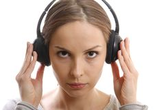 Young woman listening music with headphones Stock Image