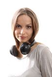 Young woman listening music with headphones Stock Photography