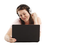 Young woman listening music on her laptop Stock Photo