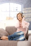 Young woman listening music at home Royalty Free Stock Images