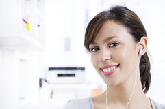 Young woman listening music in home interior Royalty Free Stock Image