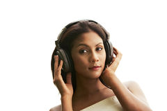Young woman listening music (isolated) Royalty Free Stock Photos