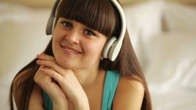 Young woman listening music and laughing stock video