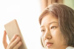 Young woman listening music from mobile phone Royalty Free Stock Photography