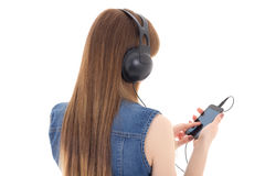 Young woman listening music with mobile phone isolated on white. Background Royalty Free Stock Images