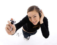 Young woman listening music from mp3 player Royalty Free Stock Photo