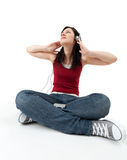 Young woman listening music from mp3 player Royalty Free Stock Photography