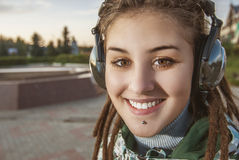 Young woman listening music Royalty Free Stock Images