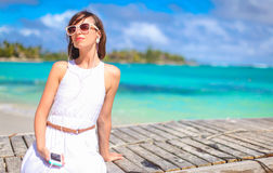 Young woman listening music on player during beach Stock Images