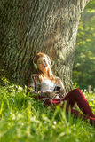 Young woman listening music Stock Image