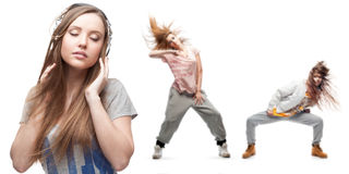 Young woman listening music and two dancers on background Royalty Free Stock Image