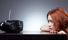 Young woman listening radio stock images