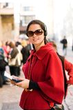 Young woman listening to audio guide Royalty Free Stock Photos