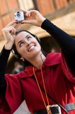 Young woman listening to audio guide Royalty Free Stock Photo