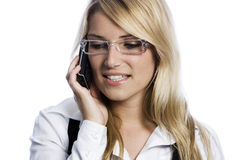 Young a woman listening to a call on her mobile Royalty Free Stock Images