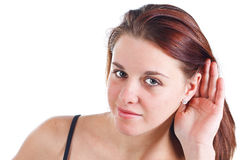Young woman listening to gossip Royalty Free Stock Image
