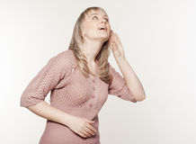 Young woman listening to gossip Royalty Free Stock Images