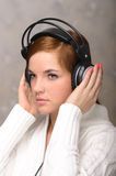Young Woman Listening to Headphones Royalty Free Stock Photography