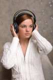Young Woman Listening to Headphones Stock Images