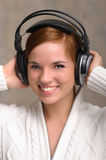 Young Woman Listening to Headphones Royalty Free Stock Image