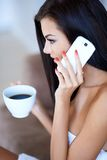 Young woman listening to a mobile phone call Stock Photos
