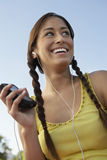 Young Woman Listening To Mp3 Player Royalty Free Stock Photography