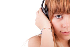Young woman listening to music. Isolated Royalty Free Stock Image