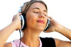 Young Woman Listening to Music Stock Image