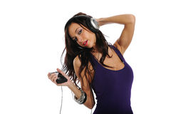 Young  woman listening to music. Young Brunette listening to music isolated on a white background Stock Image
