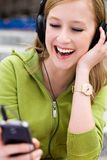 Young woman listening to music Royalty Free Stock Photos