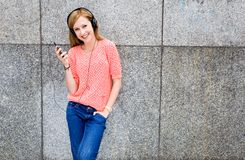 Young woman listening to music. With headphones Stock Photos