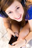 Young woman listening to music Stock Photography