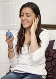 Young woman  listening to music Stock Photos