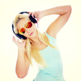 Young woman listening to the music Stock Photos