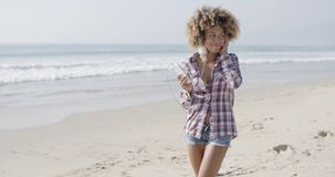 Young Woman Listening To Music At The Beach stock video