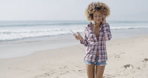 Young Woman Listening To Music At The Beach Stock Photos