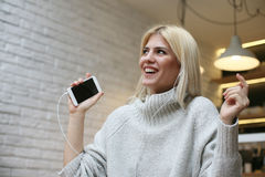 Young woman listening to music and dancing. royalty free stock photography