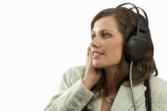 young woman listening to music on earphones, cut out Royalty Free Stock Image