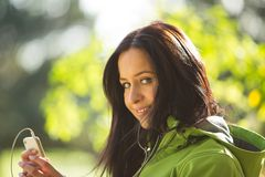 Young woman listening to music. Royalty Free Stock Images