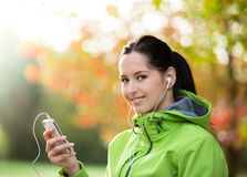 Young woman listening to music. Stock Photos