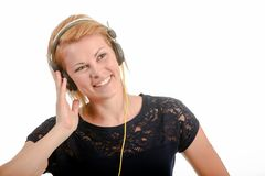 Young woman listening to music through headphones royalty free stock photo
