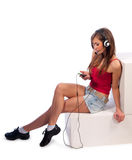 Young woman listening to music on headphones Stock Photo