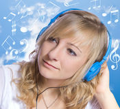 young woman listening to music on headphones. Royalty Free Stock Image