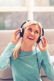 Young woman listening to music on headphones Royalty Free Stock Photography