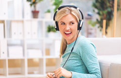 Young woman listening to music on headphones Stock Image