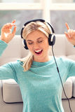 Young woman listening to music on headphones Royalty Free Stock Images